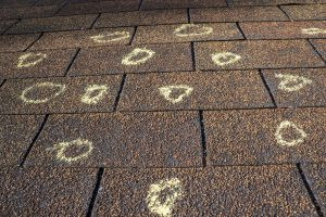 how to identify hail damage on a roof